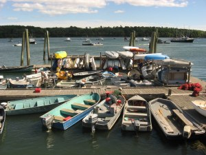 Pastel-colored boats docked at the Freeport Town Wharf