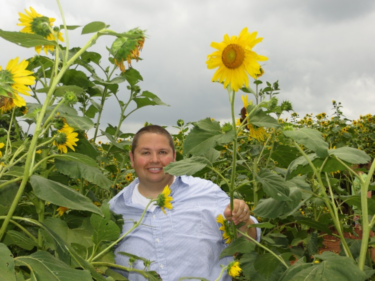 Proudly showing his freshly picked sunflower