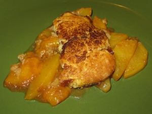 A serving of peach cobbler