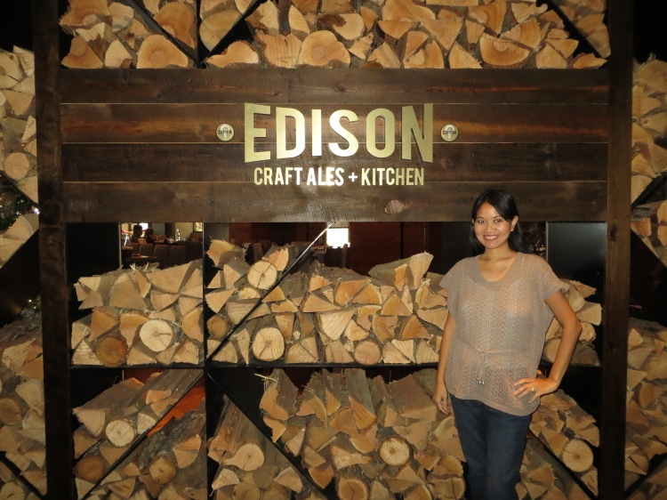 Stacked firewood at the entrance of the EDISON restaurant