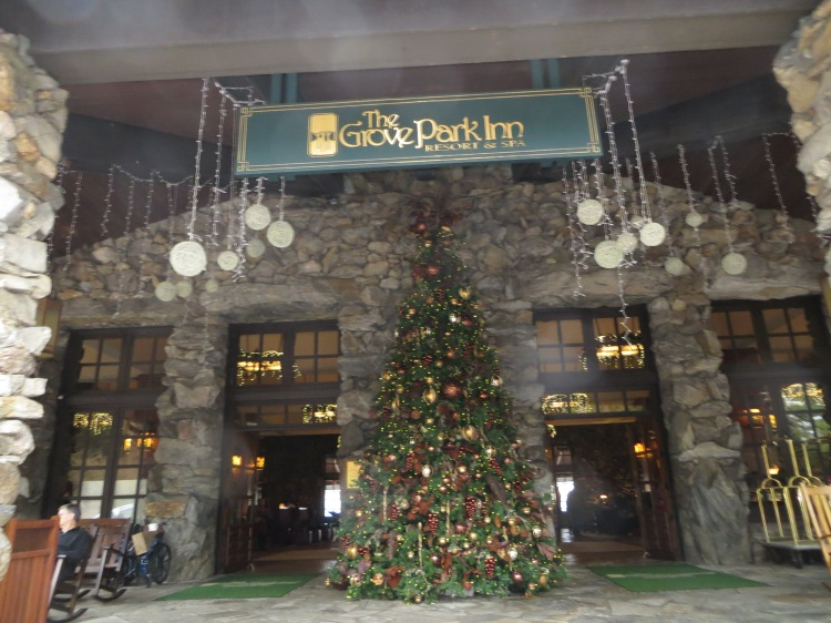 A Christmas tree standing at the front entrance of The Omni Grove Park Inn