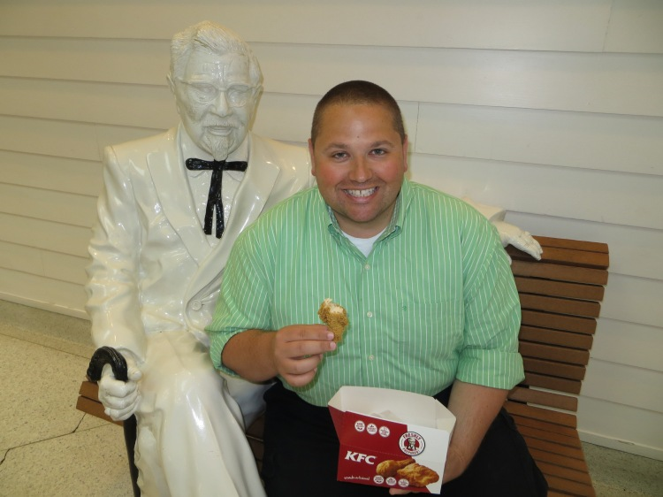 Johnny having a bite of chicken with Colonel Sanders
